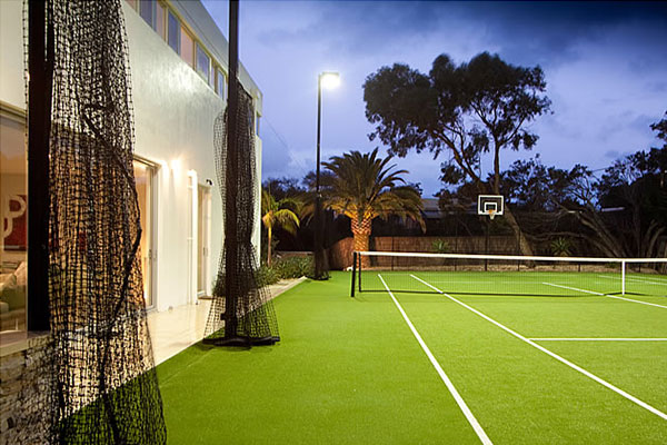 Ultracourts Tennis Court Builders - Associated Works - Draw Curtains along the side of house - pulled and tied back