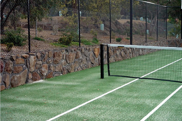 Ultracourts Tennis Court Builders - Rock Retaining Wall